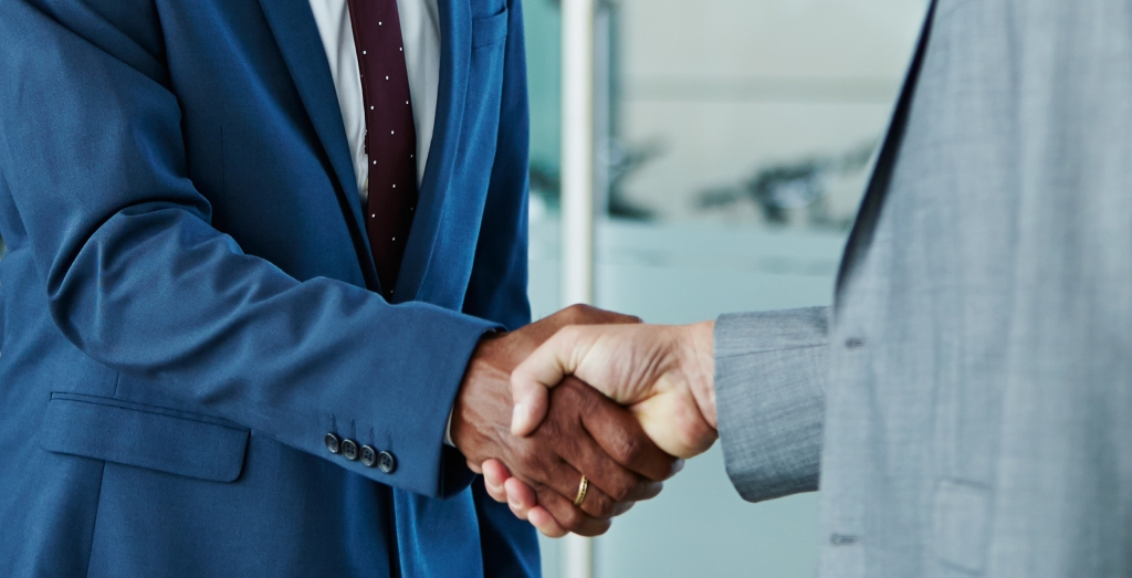 Separating Benefits: Two business men shaking hands.